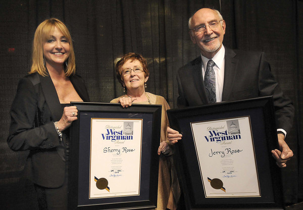 Heather Zickefoose, daughter of Jerry and Sherry Rose, presented her parents with the Distinguished West Virginia Award during the Spirit of Beckley Community Service Award Banquet.<br /> Rick Barbero/The Register-Herald