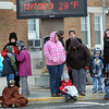 Area residents huddled together for warmth as below freezing weather made it feel very much like Christmas on Saturday afternoon during the Beckley Christmas Parade. F. Brian Ferguson/The Register-Herald