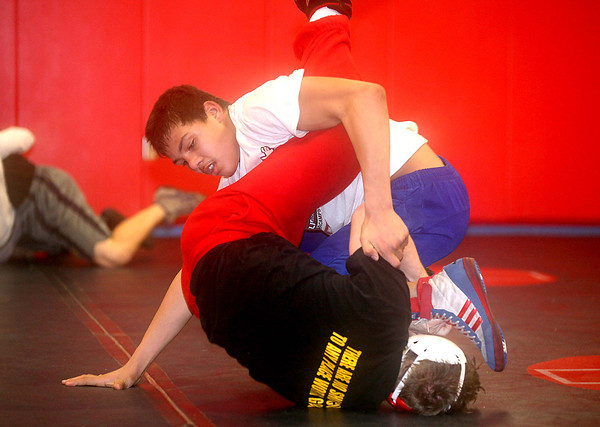 Independence Freshman Noah Adams, top, and junior Cody Clifton practice Tuesday evening in Coal City. The Patriots will take on Fairmont East a little over a week from now.<br /> Brad Davis/The Register-Herald
