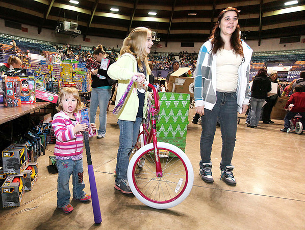 2-year-old Piper, 9-year-old Jayden and their mother, Jessica Ransom, check out the thousands of new and used toys that were available during Mac's Toy Party Saturday morning at the Beckley-Raleigh County Convention Center.<br /> Brad Davis/The Register-Herald