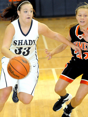 Shady Spring;s #33 moves the ball on  Summers County's #32 during Thursday evening action in Shady Spring. F. Brian Ferguson/The Register-Herald