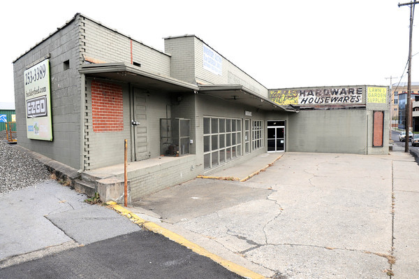 Construction crew are begining to demolishing Beckley Feed and Hardware on Prince Street preparing to build a McDonald's.<br /> Rick Barbero/The Register-Herald