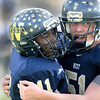 Greenbrier West QB Mark Boarwright, gets a hug from lineman Chris Gabbert, right, after a long touchdown run by Boatwright in the first quarter of Saturday's game in Fairlea, against Magnolia, to determine which team will play for the State A Football Championship next weekend in Wheeling.. F. Brian Ferguson/The Register-Herald