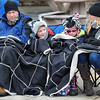 The Beebe family, from left, Chris, James,7, Emma,8, and Kimberly, all of Beckley attempted to stay warm on Saturday afternoon during the Beckley Christmas Parade. F. Brian Ferguson/The Register-Herald