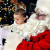 Taylor Miller, 15-months, of Beckley had her first meeting with Santa  during Saturday morning's Breakfast with Santa at Beckley Area Regional Hospital F. Brian Ferguson/The Register-Herald