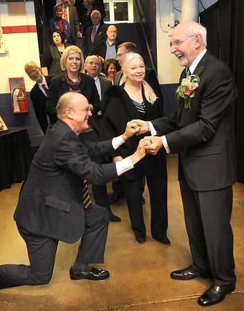 Charlie Houck, of Beckley, gets on a knee and congratulates Jerry Rose for receiving the YMCA of Southern West Virginia  Spirit of Beckley Community Service Award.<br /> Rick Barbero/The Register-Herald