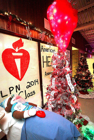 """A Christmas """"stemi"""" tree designed by Licensed Practical Nursing students sits on display during the 13th annual Festival of Trees Tuesday night at the Academy of Careers and Technology."""