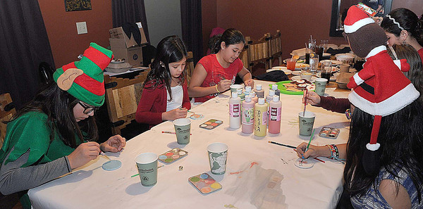 Girl Scouts from Multi-level Troop 2608 work on crafts as well as gather items for Toys for Tots on Saturday at Dish in Daniels. F. Brian Ferguson/The Register-Herald