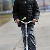 Stanley Martin, 11, of Beckley took advantage of Thursday's sunny conditions as he did laps around New River Park on his electric scooter that he received as a Christmas gift. F. Brian Ferguson/The Register-Herald