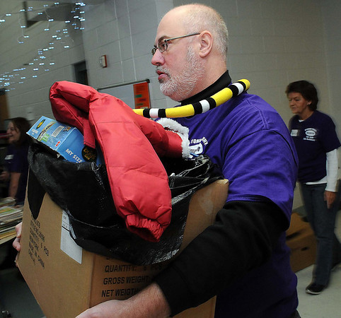 Wyoming County Prosecutor Mike Cochrane joined in with volunteers on Sunday during the Wyoming County Toy Fund at Wyoming East High School. F. Brian Ferguson/The Register-Herald