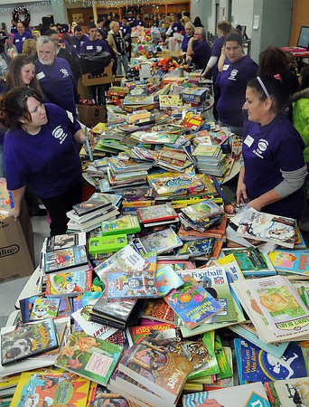 Their was no shortage of books on Sunday during the Wyoming County Toy Fund at Wyoming East High School. F. Brian Ferguson/The Register-Herald