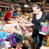 Sprague resident Lariat Blevins picks out toys for her 4-year-old daughter Star and 1-year-old son Remington during Mac's Toy Party Saturday morning at the Beckley-Raleigh County Convention Center.<br /> Brad Davis/The Register-Herald