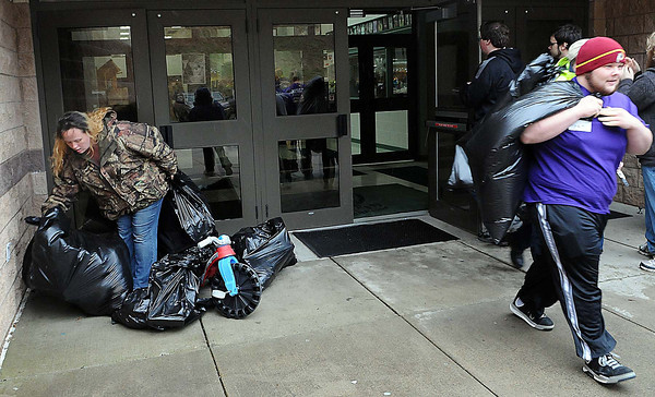 Volunteers aided local residents to carry toys to their cars on Sunday during the Wyoming County Toy Fund at Wyoming East High School. F. Brian Ferguson/The Register-Herald