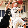 Westside's Levi Lambert drives hard to the basket as Tug Valley's Thomas Baisden defends Friday night in Clear Fork.<br /> Brad Davis/The Register-Herald