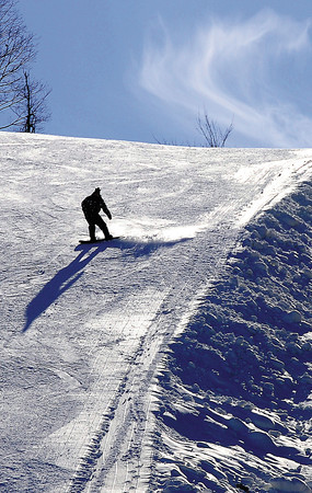 A lone snowboarder made his way down the powdery slopes of Winterplace on Friday's Opening Day of the new season. F. Brian Ferguson/The Register-Herald