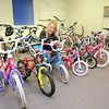 Paige Pipane, associate broker Century 21 First Choice, inspects bike donated for the Mac's Toy Fund. Beckley Board of Realtors Bike Drive is in need of money donations and bikes. Bikes can be dropped off at Century 21 across from Crossroads Mall and ERA Advantage Reality on Robert C Byrd Drive in Beckley. Contact people are Paige Tipane, 304-222-0745, or Sarah Milam, 304-923-1137.<br /> Rick Barbero/The Register-Herald