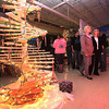 Two interested onlookers take in the sights of all the unique Christmas tree designs as they pass a wooden tree, left, created by carpentry students during the 13th annual Festival of Trees at the Academy of Careers and Technology Tuesday night.<br /> Brad Davis/The Register-Herald