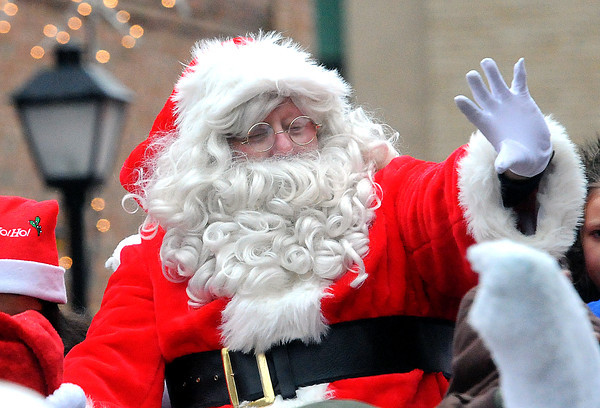 Santa waved to the children on Saturday afternoon during the Beckley Christmas Parade. F. Brian Ferguson/The Register-Herald