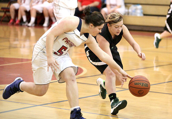 Independence High's Erica Taylor races for a loose ball with Wyoming East's Breanna Allen during the Warriors' blowout win over the Patriots Monday night in Coal City.<br /> Brad Davis/The Register Herald