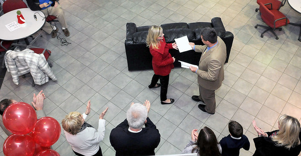 L&S Toyota Owner, Shawn Ball, right, handed out $1,000 checks to the represenatives of 16 different schools in Southern West Virginia on Friday at the dealership.  F. Brian Ferguson/The Register-Herald