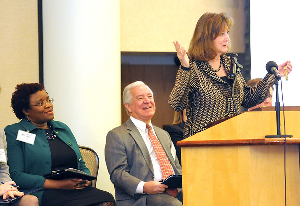 Jane Vincent, region 3 administrator U.S. Department of Housing and Urban Development, speaks during the Blueprint Summit held at Tamarack Conference Center. Listening from left, Michelle Foster, Kanawha Institute for Social Research & Action and Congressman Nick Rahall.<br /> Rick Barbero/The Register-Herald