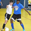 Tony Stover left fights for ball position over Colin Plante during there indoor soccer match at the School of Harmony gym in Beaver on Saturday. Photo by Chris Tilley