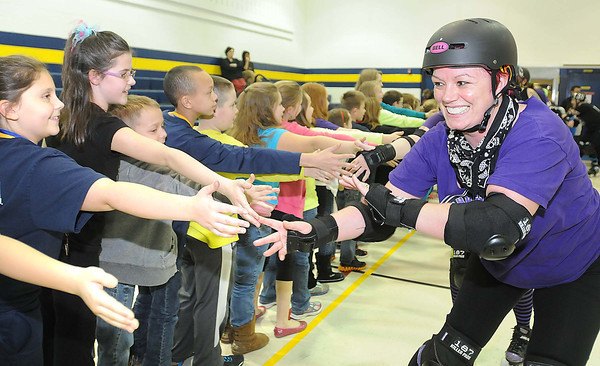Beckley Area Derby Dames did a victory skate around the Shady Elementary School gym and was greeted by the 4th and 5th graders.<br /> Rick Barbero/The Register-Herald