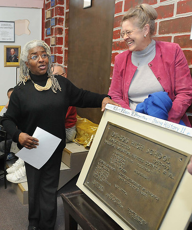 Jean Evansmore, president Dubois on Main, left, and Sudana Greene, president Mt.Hope Heritage and Hope, display the historic plaque during a dedication ceremony at DuBois on Main in Mt. Hope Saturday afternoon.<br /> Rick Barbero/The Register-Herald