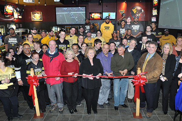 Buffalo Wild Wings in Prospetity ribbon cutting ceremony. Pictured cutting the ribbon from left, Charlie Houck, Raleigh County Chamber of Commerce Board Member, Delegate Linda Sumner, Ellen Taylor, president Chamber of Commerce, Carey Kelilitz, general manager Buffalo Wild Wings, Michael Betten, owner Buffalo Wild Wings and Jim Songer, board member Chamber of Commerce.<br /> Rick Barbero/The Register-Herald