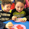 David Burgess, left, and Ben Oit Chernev, work on Valentines they made for Veterans in Kim Simpson's kindergarten class at Stanaford Elementary School. <br /> Rick Barbero/The Register-Herald