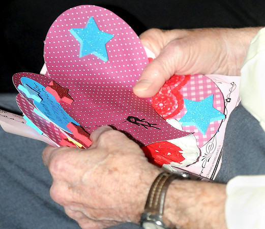 F. BRIAN FERGUSON/THE REGISTER-HERALD= Veterans were each given a Valentine's card that were made by sturents of Mabscott, Hollywood, and Stanaford Elementary schools. on Thursday afternoon at the Beckley VA.