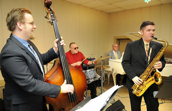 David Burnside, left, George Campbell, Robert A Burnside and Chris Oxley, all with the Chris Oxley Quartet, perform during the St. Stephens Episocpal Church Mardi Gras dinner. New Orleans-style dinner was served.<br /> Rick Barbero/The Register-Herald