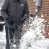 With the recent snow fall Saturday Wes Fondale works to clear his driveway in Beckley. Photo by Chris Tilley