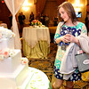 Emma Tibbs looks over a wedding cake at The Greenbrier Wedding Showcase on Sunday. Photo by Chris Tilley