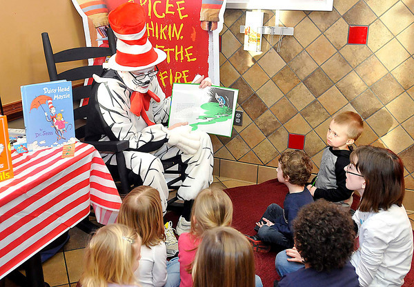 Larry Ford dressed as the Cat in that reads Dr. Seuss classic children's books to a group of kids at Chick-fil-A on Eisenhower Drive Beckley. Photo By Chris Tilley