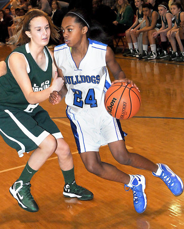 F. BRIAN FERGUSON/THE REGISTER-HERALD=Park's Ashlee Lane, left, defends as Beckley-Stratton's Kaliyan Creasey,right, drives the ball during Thursday evening's Girls Middle School County Championship game at Independence Middle School.