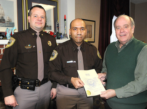 New Beckley police offficer, Joe Stewart, center, was sworn in by Beckley mayor, Emmett Pugh, right, and Beckley chief of police Tim Deems, left, on Tuesday morning in the Mayors office on South Kanawha in Beckley.<br /> Rick Barbero/The Register-Herald