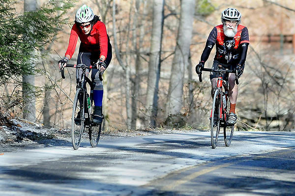 F. BRIAN FERGUSON/THE REGISTER-HERALD=Casey Gioeli, left, of Fayetteville and Carlos Plumley, right, of Oak Hill and both members of the New River Bicycle Union, take advantage of a sunny Wednesday afternoon as they make their way out of Thurmond on the Jon Dragan Road.