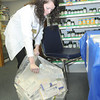 Julie Brown, WVU pharmacy student, opens up a bag full of medicine during the Drug disposal day at Colony Drug on Robert C. Byrd Drive in Beckley Monday afternoon.<br /> Rick Barbero/The Register-Herald