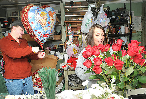 David Prince, left, and Tina Sakull work on Valentine's Day displays at Webbs Florist on South Kanawha Street in Beckley.<br /> Rick Barbero/The Register-Herald