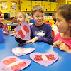 Carlie Byrant, left, Emily Bennett, Aidan Kneeland and Isabella Umberger, work on Valentines they made for Veterans in Kim Simpson's kindergarten class at Stanaford Elementary School. <br /> Rick Barbero/The Register-Herald