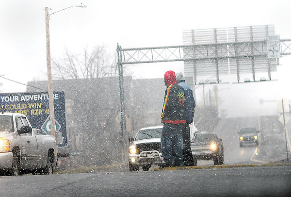 F. BRIAN FERGUSON/THE REGISTER-HERALD=Friday's morning sun slowly gave way to cold and snow as afternoon commuters make their way along Robert C. Byrd Drive in Beckley.