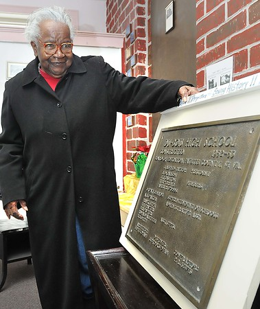Eunice Fleming, 90, graduated from DuBois High School in 1940, also was a teacher at the school from 1944-56, looks over the historic plaque after the dedication ceremony at DuBois on Main in Mt. Hope Saturday afternoon.<br /> Rick Barbero/The Register-Herald