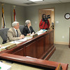Raleigh County Commissioners, Pat Reed, left, Dave Tolliver and Linda Epling, listens to Mike Queen speak during the Commission meeting<br /> Rick Barbero/The Register-Herald