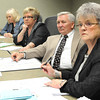 Raleigh County Commission meeting. Pictured from left, Gloria Tolbert, Raleigh County deputy clerk. Raleigh County Commissioners, Pat Reed, Dave Tolliver and Linda Epling<br /> Rick Barbero/The Register-Herald