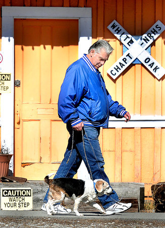 """F. BRIAN FERGUSON/THE REGISTER-HERALD=Watchin Their Steps=Randy Propps and his 15 year-old dog """"Lady"""" enjoy a sunny, Spring-like Tuesday afternoon as they take their daily walk past the White Oak depot in Oak Hill. """"Our daily walks are good for both of us,"""" claimed Propps."""