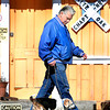 "F. BRIAN FERGUSON/THE REGISTER-HERALD=Watchin Their Steps=Randy Propps and his 15 year-old dog ""Lady"" enjoy a sunny, Spring-like Tuesday afternoon as they take their daily walk past the White Oak depot in Oak Hill. ""Our daily walks are good for both of us,"" claimed Propps."