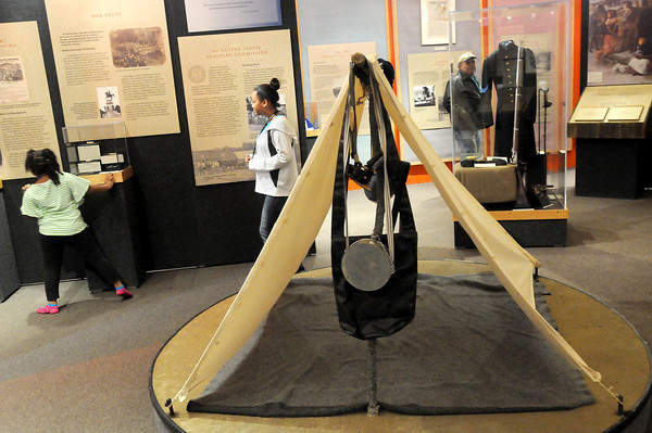 F. BRIAN FERGUSON/THE REGISTER-HERALD=Tents, swords and uniforms are among the many items found at the new exhibit at the Youth Science Museum.