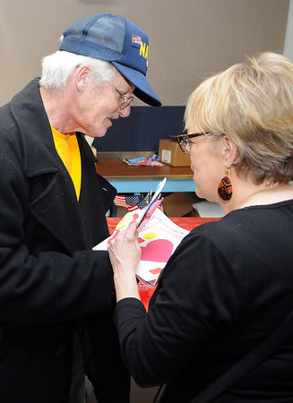 F. BRIAN FERGUSON/THE REGISTER-HERALD=Navy Veteran Vernon Hughes, left recieves a Valentine's card from Louann Grose of TWV as cast members played songs from their famous outdoor drama on Thursday afternoon at the Beckley VA.