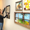 Karen Lilly, director Beckley Art Group, is preparing for the the new exhibit at the Beckley Art Gallery on Johnstown Road in Beckley.<br /> Rick Barbero/The Register-Herald